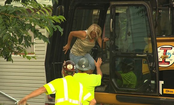 Demolition of Ariel Castro's house began around 7:30 a.m. Wednesday, August 7, 2013, as an aunt of another former Castro captive, Georgina DeJesus, made the first hit on the house, operating a hydraulic excavator with assistance.