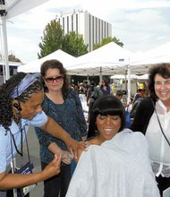 Public health nurse Deanna Bressler-Montgomery gives Tdap immunization to Compton Mayor Aja Brown at the city's Back-to-School Family Health Fair on Aug. 2. The event, co-sponsored by South Los Angeles Health Projects and the Immunize L.A. Families Coalition, was held at the Compton Town Center. Looking on are Soledad Ramirez, member of the Immunize L.A. Families Coalition, and Heidi Kent, executive director, South L.A. Health Projects. Brown decided to become immunized after Oliver Brooks, M.D., chair of the Immunize L.A. Families Coalition, encouraged her to protect herself and those around her.