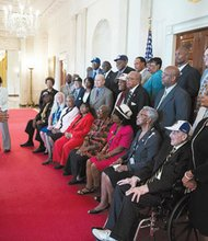 On Monday, President Barack Obama met with former Negro League baseball players in the Blue Room to honor their contributions to our nation's history, civil rights and professional baseball. Above are former Negro League baseball players and their family members in the Cross Hall of the White House.