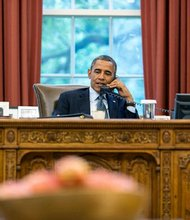 President Barack Obama talks with President Vladimir Putin of Russia during a phone call in the Oval Office, July 12, 2013.