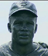 New York City, NY A statue of Brooklyn Dodger baseball pioneer Jackie Robinson and Pee Wee Reese has been vandalized, with several racial slurs scrawled with black marker on its base. NYPD told WPIX that the statue, at MCU Park in Coney Island, was discovered tagged at 8:30 a.m. Wednesday.