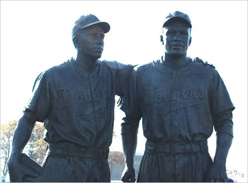 """Nearly four months after """"42"""", a biopic of Jackie Robinson was released, vandals marked a statue of Robinson with racial ..."""