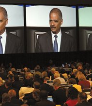 U.S. Attorney General Eric Holder speaks at the annual meeting of the American Bar Association's House of Delegates on Monday, August 12, 2013.