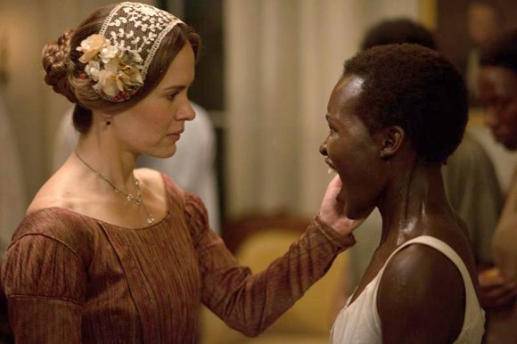"Sarah Paulson as ""Mistress Epps"" and Lupita Nyong'o as ""Patsey"" in Steve McQueens's ""12 Years A Slave."""