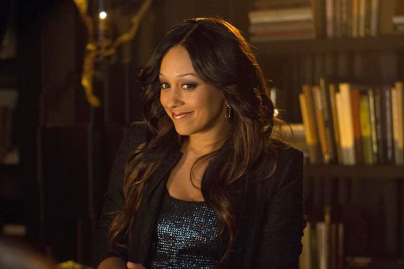 """Tia Mowry-Hardict as """"Janine"""" in """"Baggage Claim."""""""