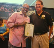 """(Right) Kevin Liles received a plaque from Baltimore County Executive Kevin Kamenetz at the """"Kevin Liles for a Better Baltimore Foundation"""" back to school event last year. The back to school festival this year will be held on Saturday, August 24, 2013 at Security Square Mall from noon to 4 p.m."""