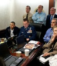 President Barack Obama and Vice President Joe Biden, along with members of the national security team, receive an update on the mission against Osama bin Laden in the Situation Room of the White House, May 1, 2011. Please note: a classified document seen in this photograph has been obscured.