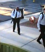 """On June 27, 2013 at approximately 6:20 a.m., the suspects pictured committed a residential robbery in the area of Flamingo and Buffalo. The suspects, dressed like Mormon missionaries, knocked on the victim's door asking to speak to him about religion. The victim spoke to them for approximately five minutes and was then jumped and punched by the suspects. The suspects demanded property from the victim while holding him at gunpoint. Once receiving property from the victim, the suspects fled. Suspect #1 is described as a White male, 22-28 years old, 5'7""""-5'8"""", 130-145 lbs. He was last seen wearing a white shirt, black tie, black pants and black shoes. He was carrying a black backpack and was armed with a handgun. Suspect #2 is described as a Black male, 22-28 years old, 5'10""""-6'1"""", 190-210 lbs. He was last seen wearing a white shirt, black tie, black pants and black shoes."""