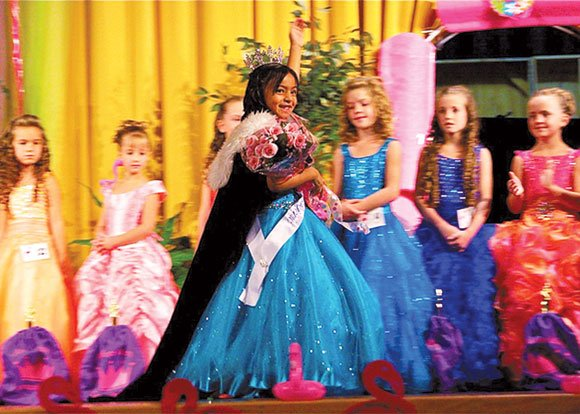 Floriani Escobar, the reigning Little Miss Edwards 2013, and daughter of Santos (412th Special Instrumentation) and Griselda Escobar, recently won the title of Little Miss Antelope Valley 2013.