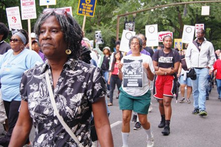 Participants of a rally of upwards of 1,000 people gather in downtown Portland Saturday to commemorate the historic March on Washington for Jobs and Freedom 50 years ago. A host of civil rights issues were addressed.