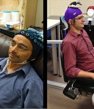 Researchers at the University of Washington have demonstrated what they say is the first example of a noninvasive human-to-human brain interface. In a video posted online, they show how a scientist could control another scientist's hand motions just by using brain signals sent over the Internet. Rajesh Rao, left, send brain signals to Andrea Stocco, right, in a different laboratory.