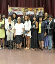 The Fame Education and Scholarship Commission, whose 10 members are pictured here with this year's 14 winners, Saturday awarded 12 $1,000 scholarships and two $500 book scholarships to college freshmen, juniors, sophomores, seniors as well as two graduate students.