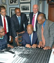 Rep. John Lewis (D-GA) reviews the schematic of the Civil Rights Foot Soldiers Memorial in his Washington office last Thursday with members of the organizing committee. The unveiling will take place on Wednesday in Annapolis. Pictured from left, Jacqueline Boone Allsup, President-Anne Arundel County Branch NAACP, Joshua J. Cohen, Mayor of Annapolis, Daryl D. Jones, Esq., Guarantor, US Rep. John Lewis, Marc L. Apter, PR Director for Foot Soldiers Memorial, Carl O. Snowden, Chairman Dr. Martin Luther King Jr. Committee, Inc. and Chief Joseph Johnson, Guarantor.