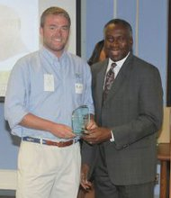 (Left): Matt Hargrove of Total Home Performance accepted an award for top performing contractor – home complete.