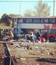 A double-decker bus and a passenger train collided in Ottawa on Wednesday morning, September 18, 2013, killing six people and injuring at least 30 others, authorities said.