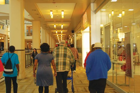 """A group of seniors take part in a Meals on Wheels program designed to keep elders active called """"Walk With Ease."""" Led by the Urban League of Portland's Multicultural Senior Center Director Arleta Christian, the participants, all aged 60+, strolled the halls of Lloyd Center Mall as part of a 6-week effort to increase their health."""