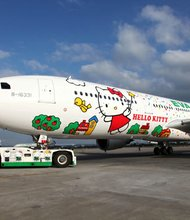 Last week, Taiwan-based EVA Air launched its first long-range jet — flying between Taipei and Los Angeles — emblazoned with everyone's favorite mouthless cat. Not just the fuselage, but everything on the EVA's feline flying machines is Kitty themed, from crew members' uniforms to the coffee cups, head rests, toilet rolls and food.