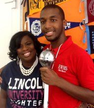 Edmondson-Westside High School counselor Phyllis White-Coley and student Xavier Clark.