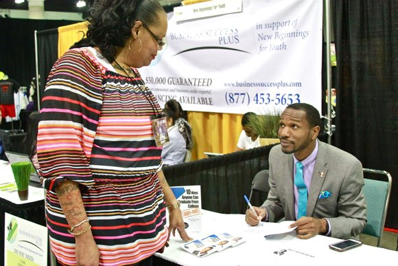 Mary Johnson gets valuable information about college best from exhibitor Kevin Brown.
