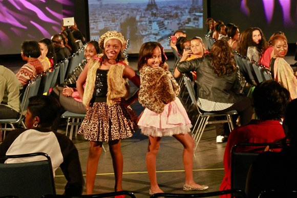 Mini models pose for the camera at the Lights, Camera, Runway! fashion show.