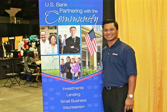 A US Bank representative takes a moment from manning the booth.