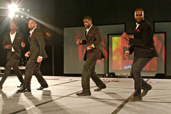 Members of Kappa Alpha Psi Fraternity Inc. groove during their step routine.