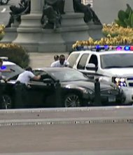 This exclusive image taken from Alhurra Television shows the car that was being chased by authorities in DC, which ended in U.S. Capitol police opening fire on Thursday, October 3, 2013.