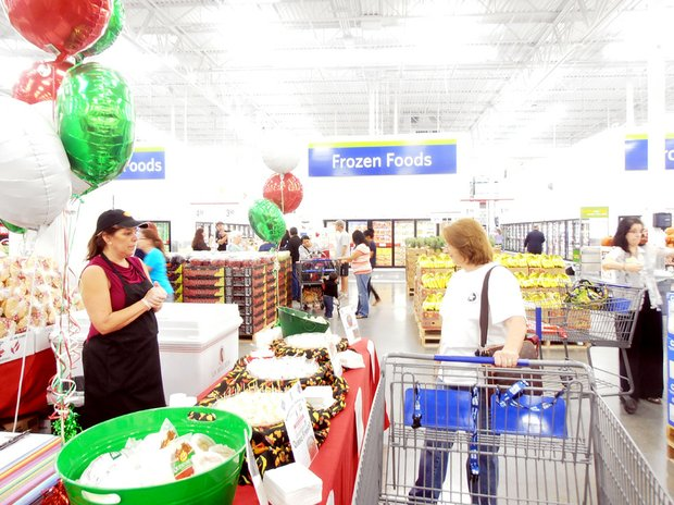 A shopper samples some of the free offering during the grand opening.