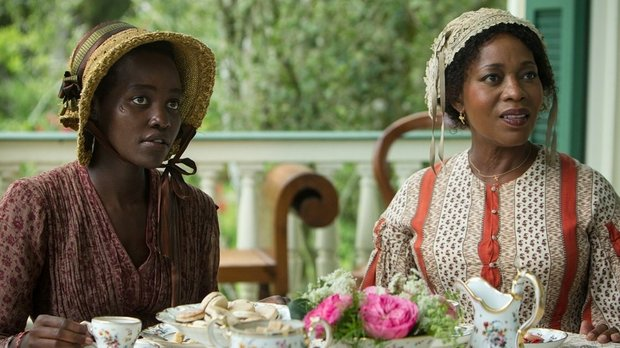 """Lupita Nyong'o as Patsey and Alfre Woodard as Mistress Harriet Shaw in """"12 Years a Slave"""""""
