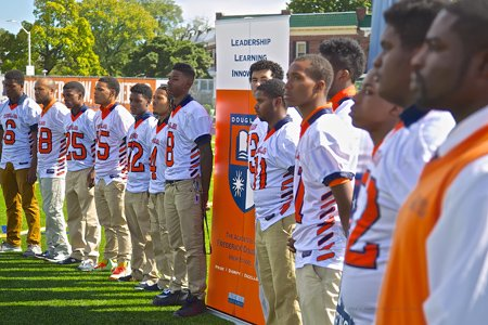 "Members of the football team at the Academies at Frederick Douglass High School will have a full time academic coach this school year thanks to the new program launched at the school by the NFL Player Engagement (NFLPE) and the Family League of Baltimore on Thursday, September 26, 2013. The ""1st & Goal"" initiative is a pilot program funded by NFLPE that is based on its successful PREP platform to prepare, educate and support young student-athletes in all facets of their lives by promoting academic excellence and effective goal setting."