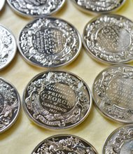 The only official UK coins being struck to commemorate the christening of HRH Prince George of Cambridge are going into production on Tuesday 8 October at The Royal Mint in Llantrisant, South Wales.