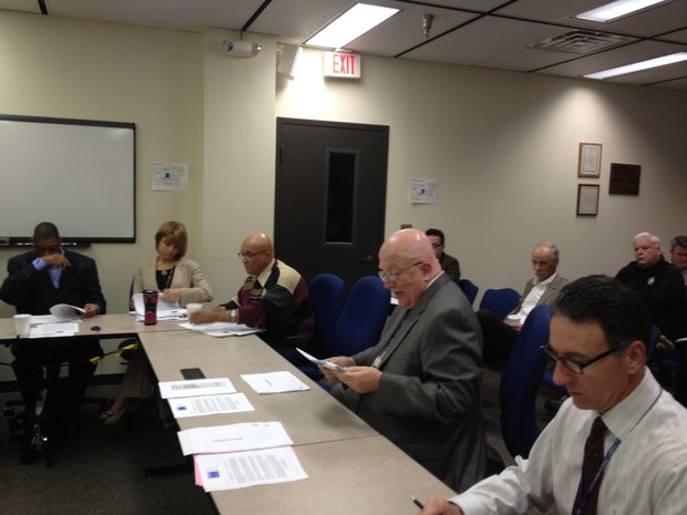 Dr. Joseph Troiani (right) discusses the shortage of psychiatrists at the Will County Health Department Tuesday at a meeting of the county board's Legislative and Policy Committee.
