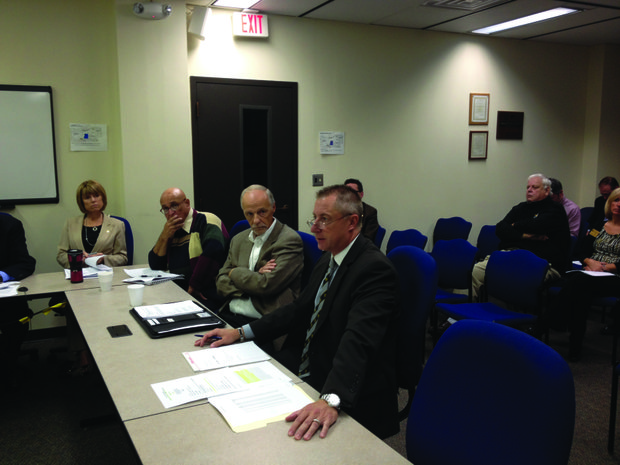 Will County Trial Court Administrator Kurt Sangmeister (far right) and the county board's lobbyist Brent Hassert (second from right) address the board's Legislative and Policy Committee on Tuesday.