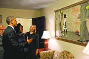"President Barack Obama, Ruby Bridges, and representatives of the Norman Rockwell Museum view Rockwell's ""The Problem We All Live With,"" hanging in a West Wing hallway near the Oval Office, July 15, 2011. Bridges is the girl portrayed the painting."