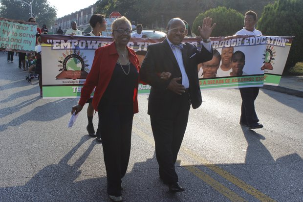 Dolores Winston, founder of the Empowerment Academy led the parade to celebrate 10 years of excellence at the school on Friday, October 4, 2013 followed by Flag bearers Trinity C. Audrey C. and Matthew J. from the eighth grade class.