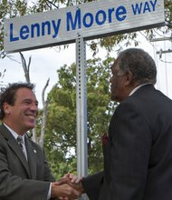 "Baltimore County Executive Kevin Kamenetz shakes hands with former Baltimore Colts player Lenny Moore at the unveiling of the road sign that ceremonially renames Resource Drive in Randallstown as ""Lenny Moore Way"" on Tuesday, October 8, 2013."