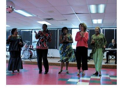 Continental Societies members dancing and enjoying live jazz music.