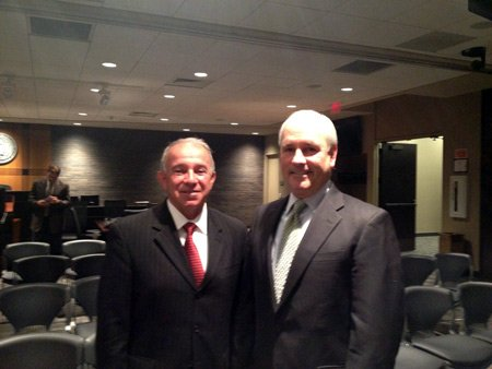 Outgoing Joliet City Manager Tom Thanas (left) stands next to new City Manager Jim Hock.