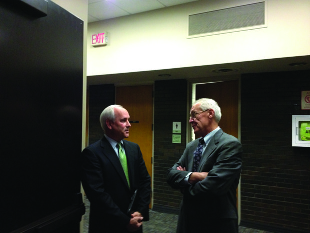 Jim Hock (left) stands in the hallway of the Joliet City Council room with Bob Beezat, consultant with Voorhees Associates, just before the council votes to appoint him to the position of city manager