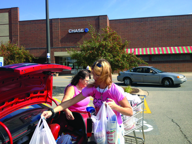 Stephanie Herek unloads groceries into her trunk after shopping at the Dominick's in Romeoville last week with her mother, Helene Hobbs.
