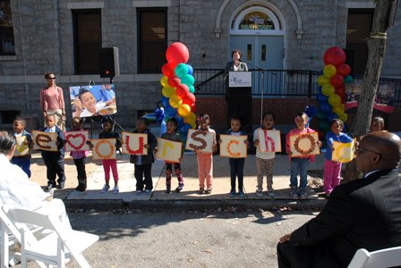 """St. Vincent de Paul of Baltimore opened a new Head Start Center on Caroline Street in the Oliver Neighborhood in Baltimore on Tuesday, October 15, 2013. (Above) Children from the new St. Vincent de Paul Head Start Center hold up letters that spell out """"We Love Our School"""" as Baltimore City Council President Jack Young (right) looks on."""