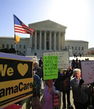 Protesters, for and against the controversial Affordable Care Act, demonstrate in front of the U.S. Supreme Court.