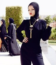 A covered-up Rihanna was decked out in a dark outfit, complete with what looked like the head gear worn by Muslim women. She posed in bright red lipstick and posted the pictures on her Instagram account.