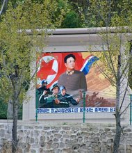 """This propaganda monument of """"Dear Leader"""" Kim Jong-Il by a countryside road, not far from the border to China, was deleted by authorities. North Korea required images of leaders be full body shots."""