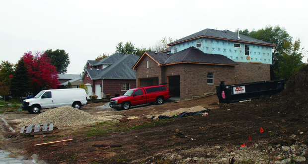 Contractors this week focused on the interior work at this new home under construction along McDonald Drive in Lockport. The city is currently facing a housing slump and is looking to reduce fees to attract more home builders.