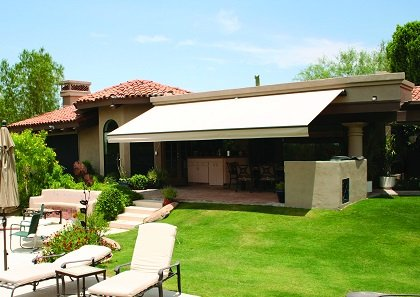 A fabric canopy or awning over your deck or patio is a great long-term solution to expand needed living space at a low cost.
