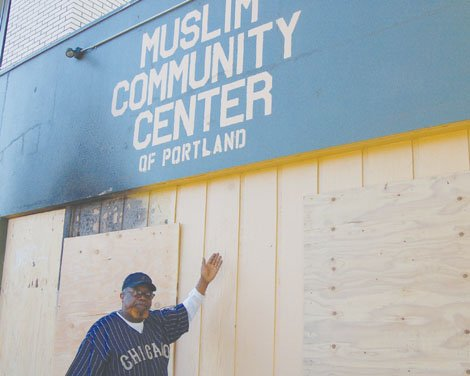 Muslim Community Center leader Omar Shabazz surveys the damage from a fire that causes extensive losses to the building and contents at 3801 N.E. Martin Luther King Blvd.