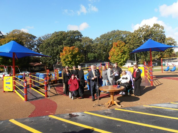 Jim Mullins, UCP President and CEO, speaks at the ribbon cutting and grand opening Thursday of the state's first fully wheelchair-accessible playground on the grounds of the United Cerebral Palsy of Illinois Praierieland, 311 S. Reed Street, Joliet.
