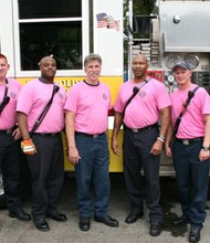 Members of Annapolis fire department Engine #35 sport pink tee shirts in support of Breast Cancer Awareness Month at the annual Robinwood Community Day block party held Saturday October 19, 2013. (Left to right): Jeff Davis; Travon Williams; Lt. Avery; Eric McCollum Sr.; and Craig McCracken.