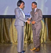 Darin Atwater receives the 2013 Top 100 MBE Prestige Award from Baltimore Mayor Stephanie Rawlings-Blake on Wednesday, October 30, 2013 during a ceremony at the mayor's Supplier Diversity and Inclusion Week at the War Memorial in downtown Baltimore.